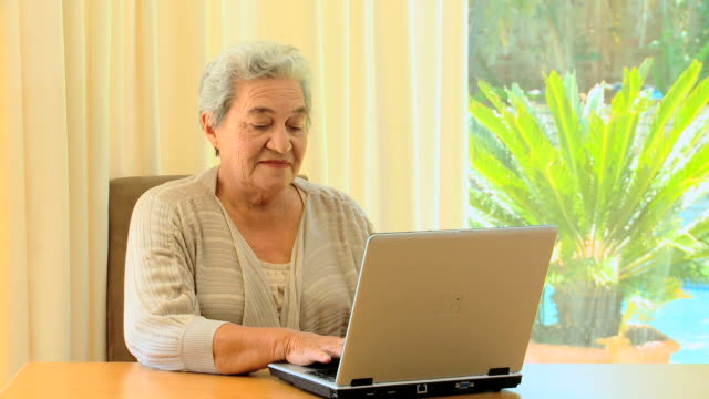 Mature woman using a laptop / Cape Town, Western Cape, South Africa