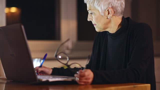 mature woman using computer - one mature woman only stock videos & royalty-free footage