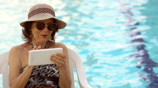 mature woman using digital tablet - 70 79 years stock videos & royalty-free footage