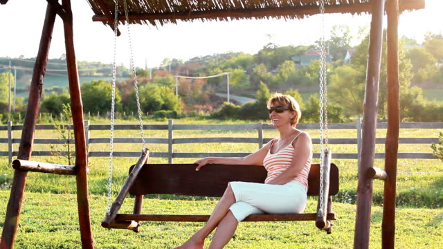mature woman - rocking chair stock videos & royalty-free footage