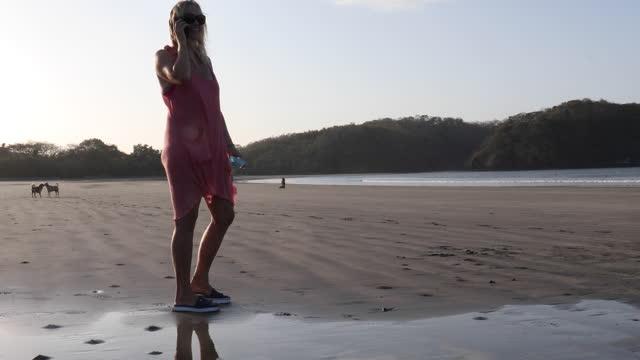 mature woman walks along empty beach, at sunrise - full length stock videos & royalty-free footage