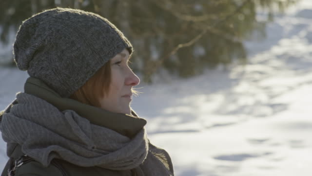 stockvideo's en b-roll-footage met mature woman warming up with coffee outside in winter - zichtbare adem
