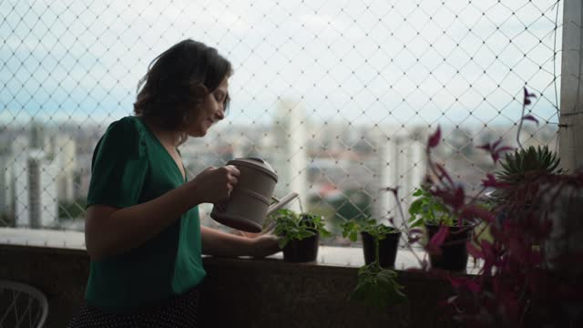 mature woman watering plants on balcony - 40 44 years stock videos & royalty-free footage