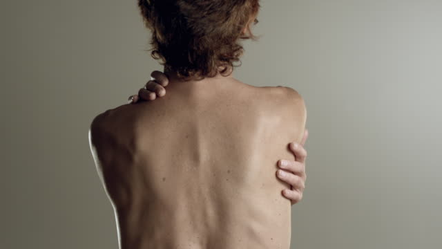 MS Mature woman with bare back, looking over shoulder / Los Angeles, California, USA