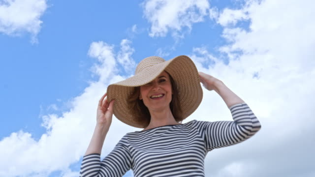 mature woman with beach hat - straw hat stock videos & royalty-free footage