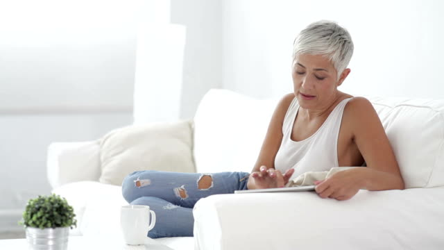Mature woman with digital tablet