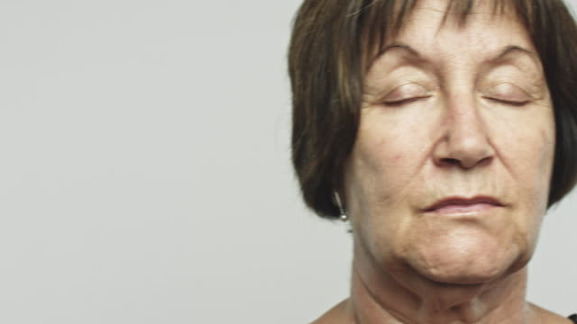 mature woman with eyes closed - blindness stock videos & royalty-free footage