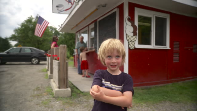 ws mature woman with grand children (4-7) standing outside americana type roadside snack bar / stowe, vermont, usa - shirtless stock videos and b-roll footage