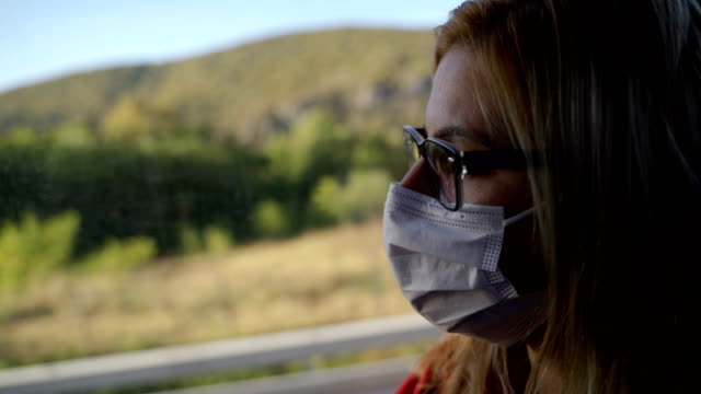 mature woman with protective face mask in the bus-corona virus travel concept - cart stock videos & royalty-free footage