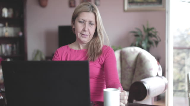 mature woman working at home - 40 44 years stock videos & royalty-free footage