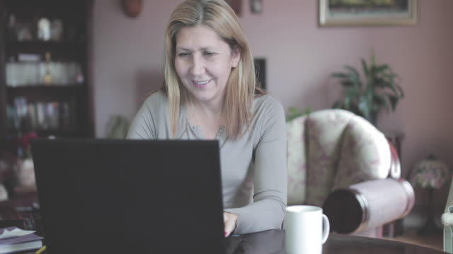 mature woman working at home - only mature women stock videos and b-roll footage