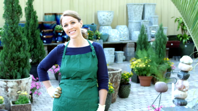 mature woman working in plant nursery - 40 49 years stock videos & royalty-free footage