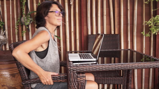 mature woman working on computer from home - postura video stock e b–roll