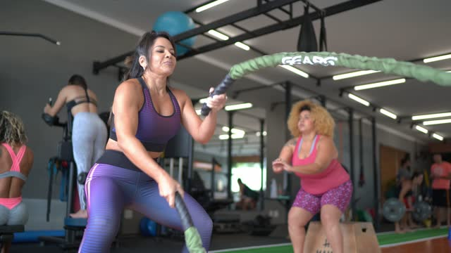 mature woman working out with battle ropes at the gym - rope stock videos & royalty-free footage