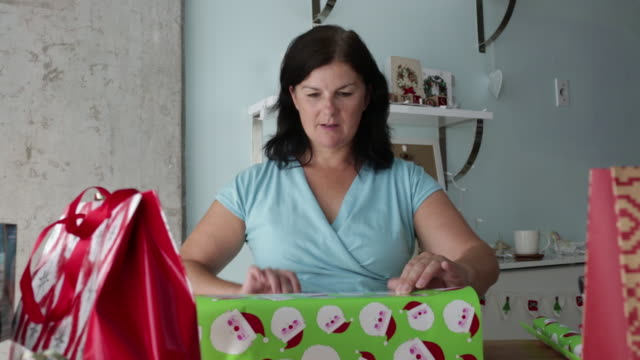 ms zo mature woman wrapping christmas gift. - wrapping stock videos & royalty-free footage