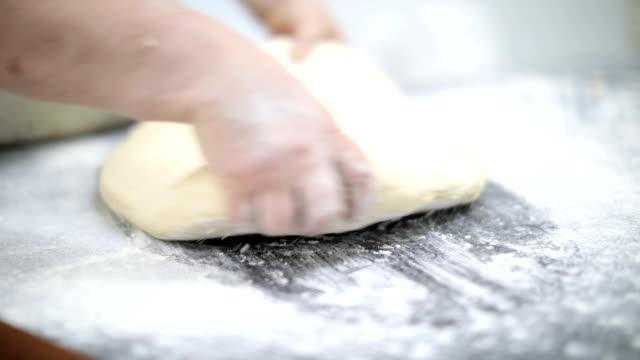 Mature women baking indoors