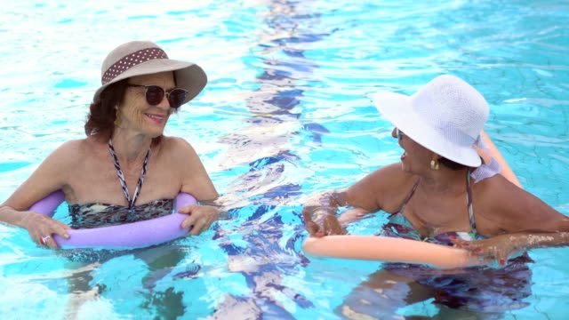 mature women exercising the body in the swimming pool - 70 79 years stock videos and b-roll footage
