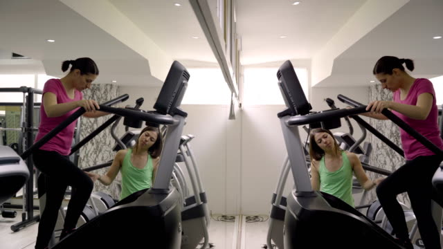 mature women have a stepper exercise in the gym - durevolezza video stock e b–roll