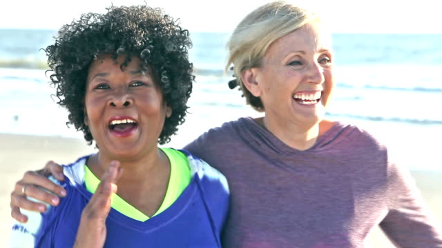 Mature women in yoga pose, finish their exercises