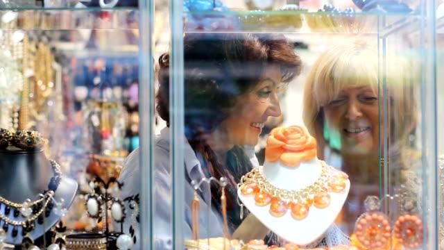 Mature women jewellery shopping