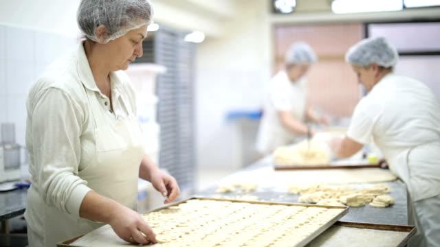mature women making pretzels - baker occupation stock videos and b-roll footage