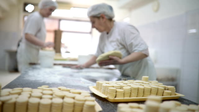 mature women working at the bakery production - caterer stock videos and b-roll footage