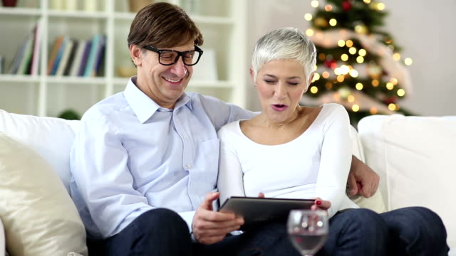 mature-senior couple shopping over internet with credit card - white hair stock videos & royalty-free footage