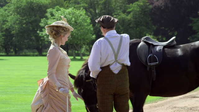 MS Maud Cunard walking towards and greeting horse at Nevill Holt / United Kingdom