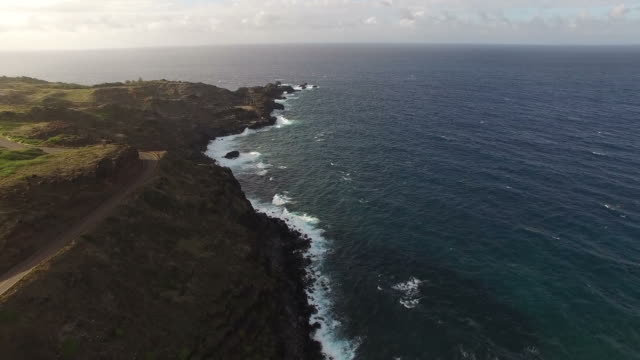 maui island as seen by ariel drone view at dusk - butte rocky outcrop stock videos & royalty-free footage