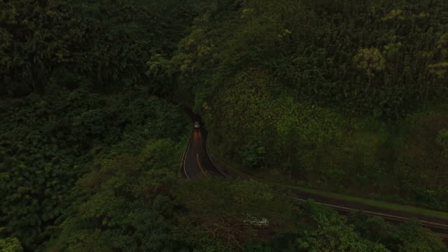 maui island coastal road winding on side of mountain - butte rocky outcrop stock videos & royalty-free footage