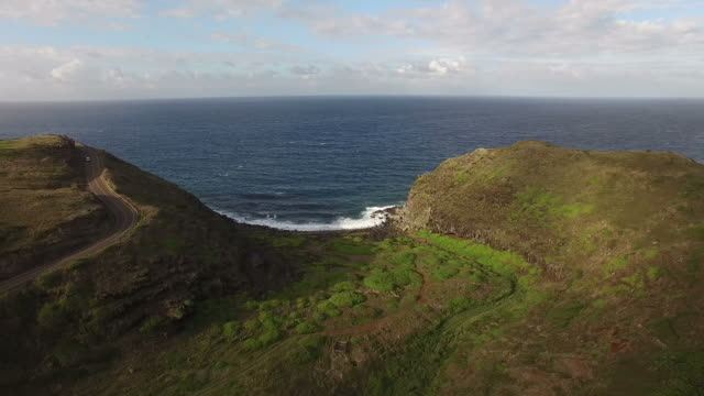 maui island hills and green landscape by drone - butte rocky outcrop stock videos & royalty-free footage