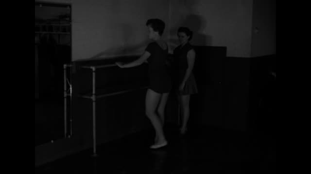 """maureen connolly, a/k/a """"little mo"""", practices on tennis court / connolly stretching on a ballet barre / connolly practicing tap dancing / scar... - barre stock videos & royalty-free footage"""