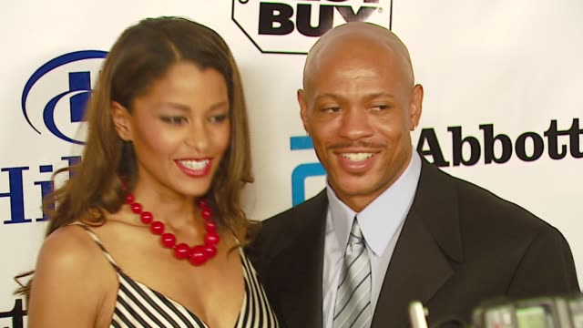 maurice green and claudia jordan at the celebrities honor magic johnson for 'magic evolution' at the beverly hilton in beverly hills california on... - magic johnson stock videos and b-roll footage