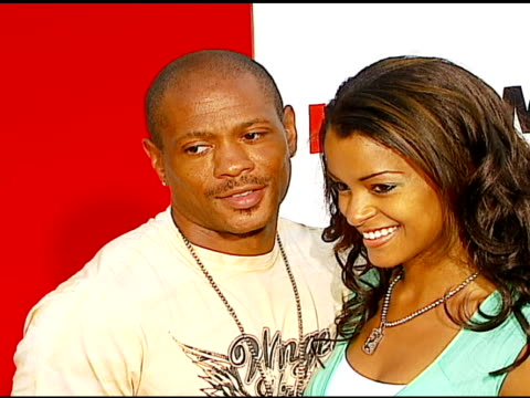 maurice greene and claudia jordan at the 'little man' premiere at the mann national theatre in westwood california on july 6 2006 - mann national theater stock videos & royalty-free footage