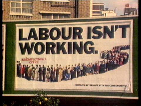 maurice saatchi leaving saatchi and saatchi ms 'labour isn't working' poster on hoarding cms 'unemployment office' on poster pull out poster on... - 1979 stock videos and b-roll footage
