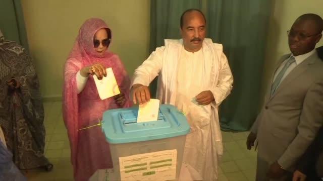 mauritanian president mohamed ould abdel aziz casts his vote in a nouakchott polling station - nouakchott stock videos & royalty-free footage