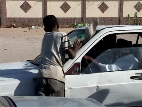 mauritania's street kids live on the social margins of one of the world's poorest countries. nouakchott, mauritania. - nouakchott stock videos & royalty-free footage