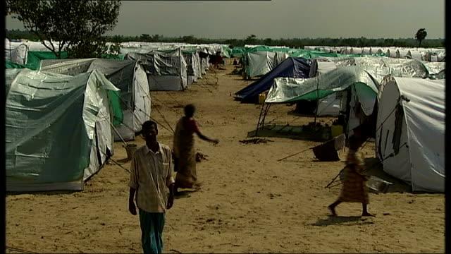 mavadivembu refugee camp sri lanka mavadivembu ext general view mavadivembu refugee camp with tents set up in rows / small child sitting on mat... - babies in a row stock videos & royalty-free footage