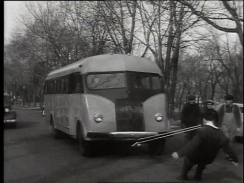 max baer pulling a bus with his teeth - 1949 stock videos & royalty-free footage