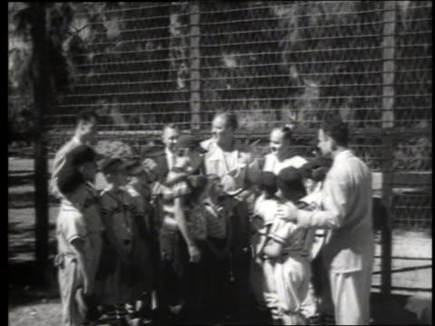 stockvideo's en b-roll-footage met max baer talking to group of boys in baseball uniforms / sacramento / sound - gemengde leeftijdscategorie