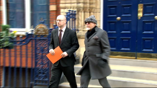 max clifford pleads not guilty to indecent assault charges lib / ext gary glitter and solicitor from building - gary glitter stock videos & royalty-free footage