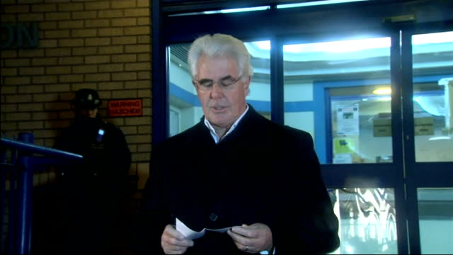 max clifford questioned by police on sexual assault allegations; england: london: ext / night **flashlight photography** max clifford emerges from... - no doubt band stock videos & royalty-free footage