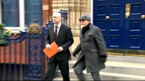 max clifford questioned by police on sexual assault allegations; lib london: gary glitter and solicitor from building to car as he prepares to travel... - gary glitter stock videos & royalty-free footage