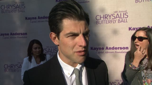 interview max greenfield on being a part of the night what he appreciates about chrysalis and the work that they do the last time someone gave him a... - chrysalis butterfly ball video stock e b–roll