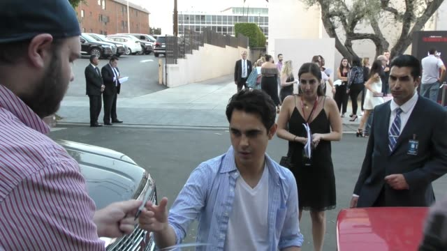 max minghella signs for fans at the handmaid's tale hulu finale panel at the wilshire ebell theatre in los angeles in celebrity sightings in los... - wilshire ebell theatre stock videos & royalty-free footage
