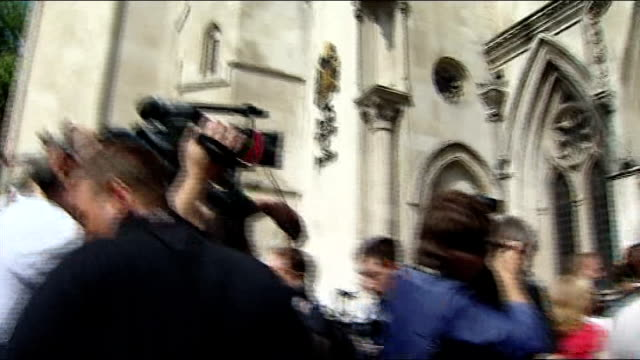 stockvideo's en b-roll-footage met max mosley out from court and statement after winning privacy case against news of the world england london royal courts of justice ext max mosley... - news of the world