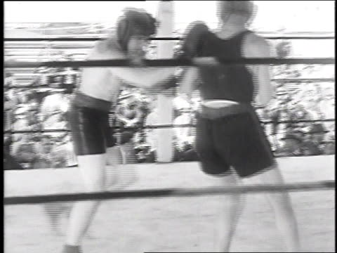 max schmeling sparring, with people in grandstand, on may 14, 1930 / long island, new york - ファイティングポーズ点の映像素材/bロール
