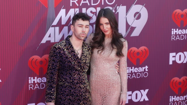 Max Schneider and Emily Cannon at the 2019 iHeartRadio Music Awards at Microsoft Theater on March 14 2019 in Los Angeles California