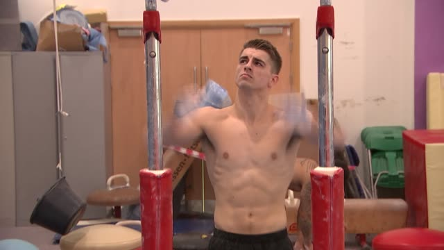 max whitlock gymnastics training general view of gym other gymnasts training / max whitlock running and jumping off of springboard onto vault table... - gymnastics bar stock videos & royalty-free footage