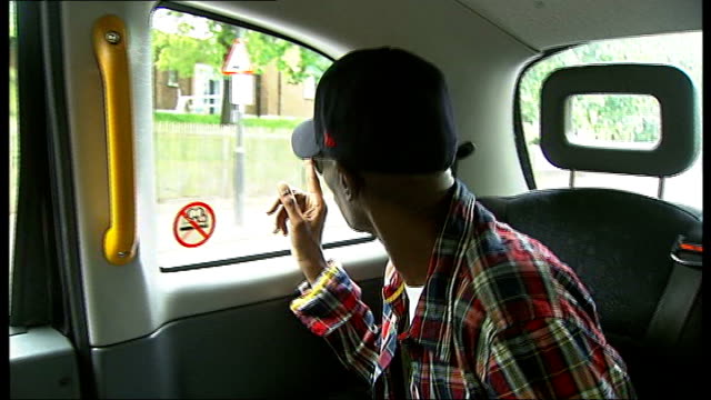 maxi jazz pointing out parts of brixton he remembers including mango landing and the brixton lido sot ext taxi along int taxi maxi jazz and sister... - ランベス点の映像素材/bロール